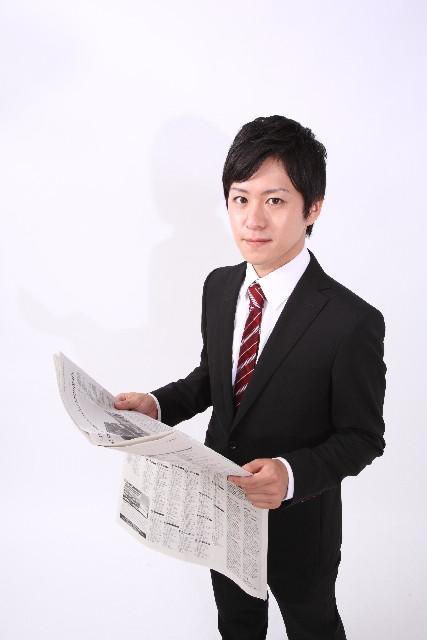 新聞とビジネスマン